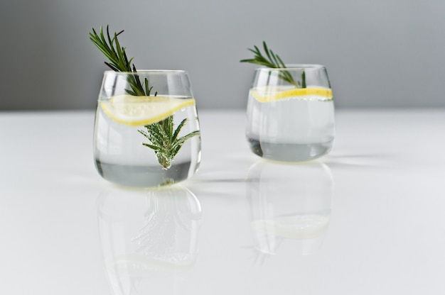 Glasse of pure water with lemon, rosemary.