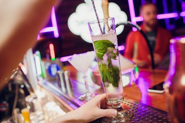 Glasses alcohol color cocktails on bar background