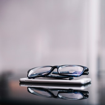Glasses and phone on table