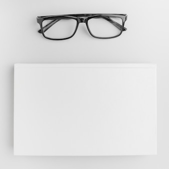 Glasses beside book on table