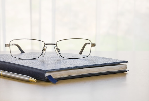 Glasses and a book on the desk