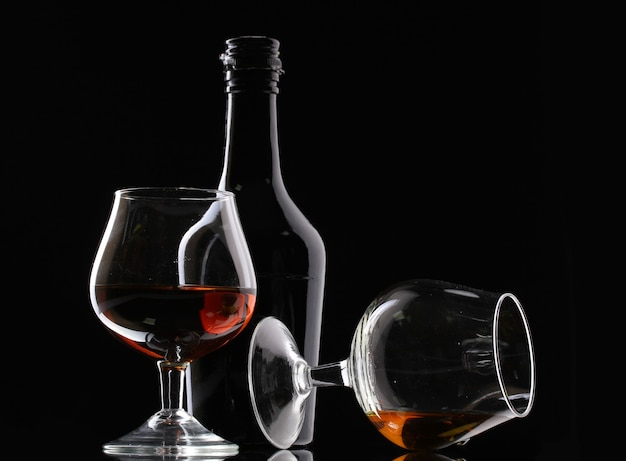 Glasses of brandy and bottle