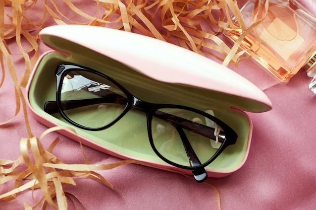 Glasses in case, stylish optics, flat lay, optics store.