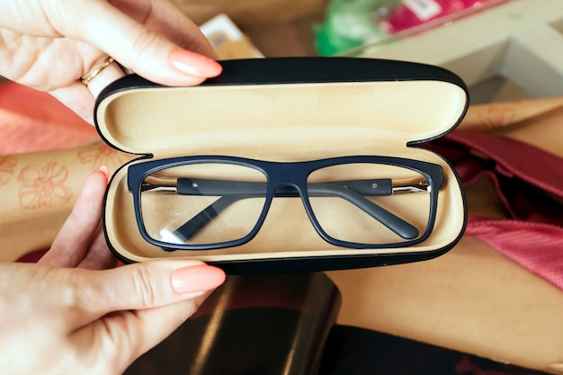 Glasses in case, stylish optics, flat lay, vintage, optics store.