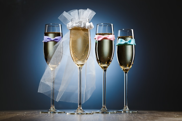 Glasses of champagne for bride and gentlemens