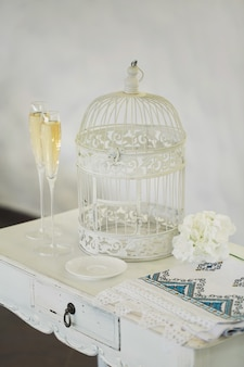 Glasses of champagne, cage, towel wedding