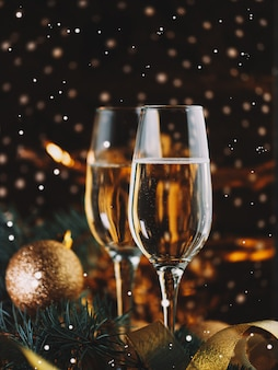 Glasses of champagne on a decorated christmas table with bokeh effect