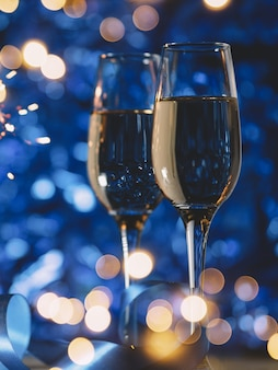 Glasses of champagne on a festive blue decoration