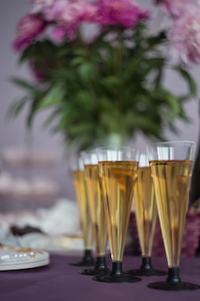 Glasses of champagne, festive table decoration concept. new year or christmas concept.