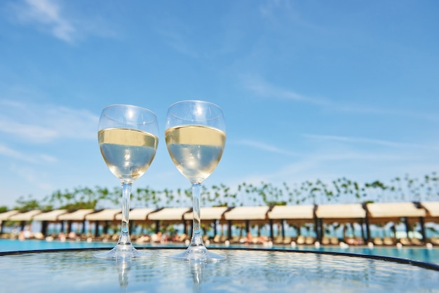 Glasses of champagne at a resort pool in a luxury hotel. party by the pool. pouring drink in a glass. amara dolce vita luxury hotel. resort. tekirova-kemer. turkey