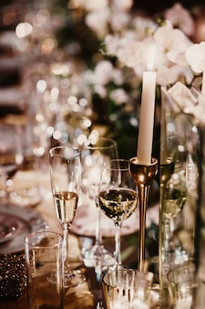 Glasses of champagne stand on a festive table