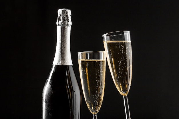 Glasses of champagne with the bottle