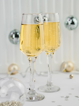 Glasses of champagne with bubbles and globes