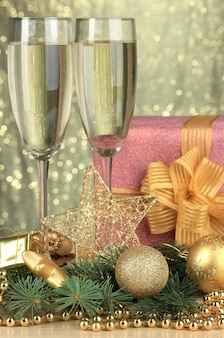 Glasses of champagne with gift box