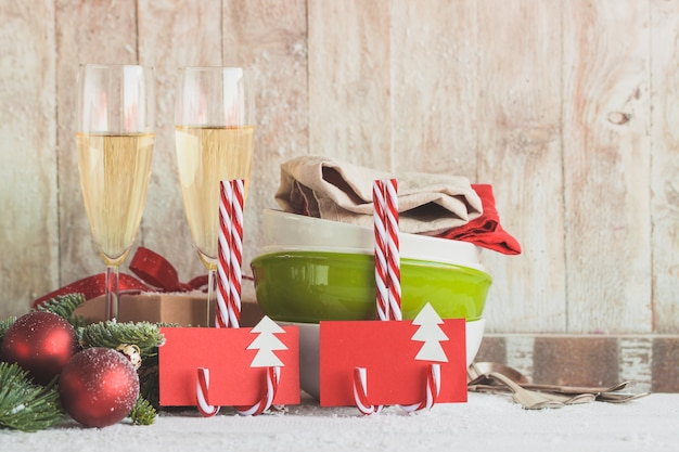 Glasses of champagne with gifts and christmas decorations
