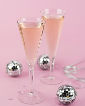 Glasses of champagne with silver globes