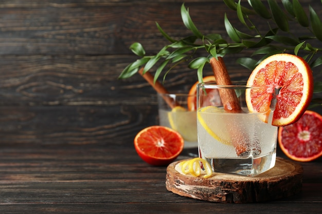 Glasses of cocktail with citrus on wooden