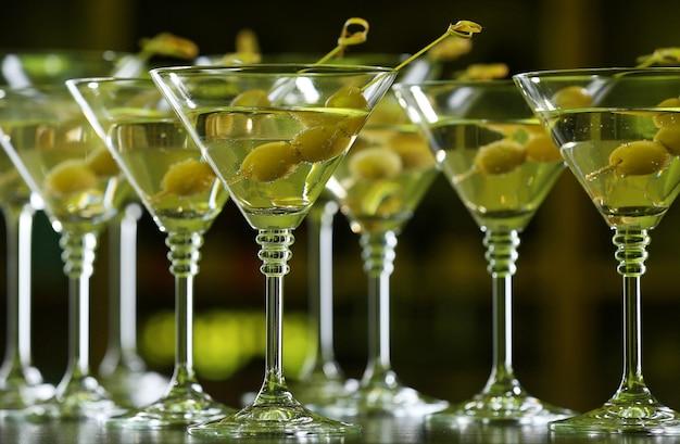 Glasses of cocktails on bar