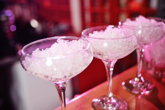 Glasses of cocktails with ice close up