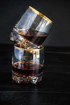 Glasses of cognac on black stone board