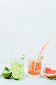Glasses of cold fruit drink with straws