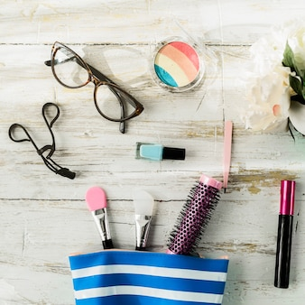 Glasses and cosmetics near makeup bag
