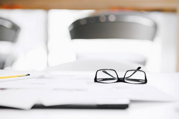 Glasses on desk in office