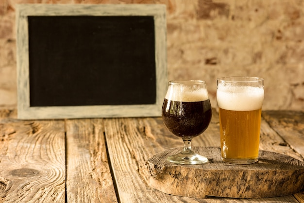 Glasses of different kinds of beer on wooden table