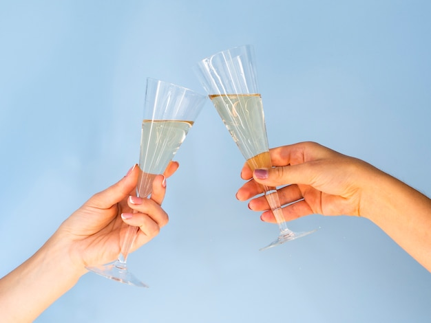Glasses filled with champagne toasting