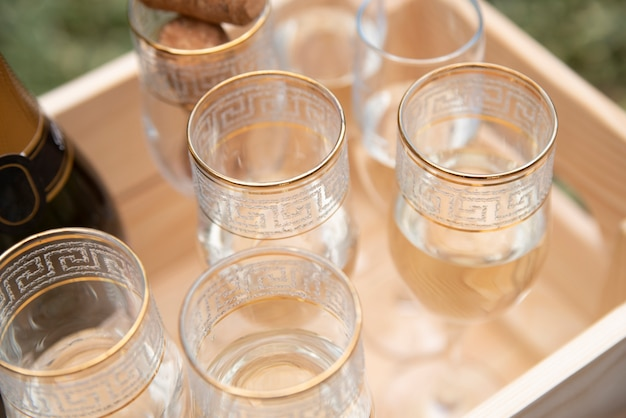 Glasses filled with champagne in wooden crate