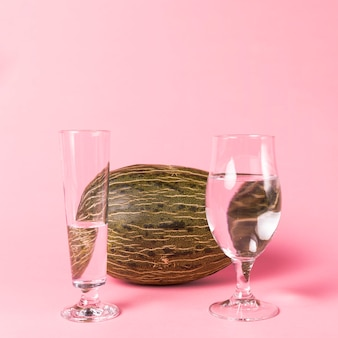 Glasses filled with water and melon