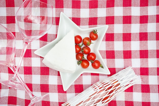Glasses food on tablecloth close up
