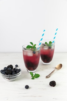 Glasses of fresh iced wild berries
