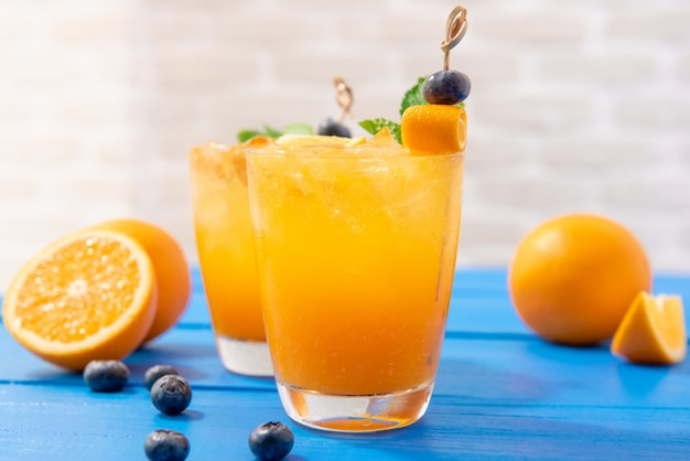 Glasses of fresh orange juice drinks