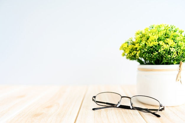 Glasses and green plants on the desk,copy space