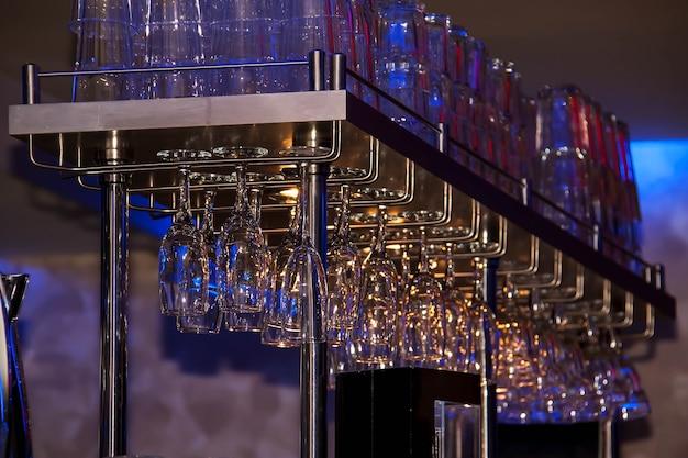 Glasses hang over the bar