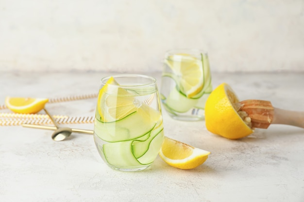 Glasses of healthy infused water on table
