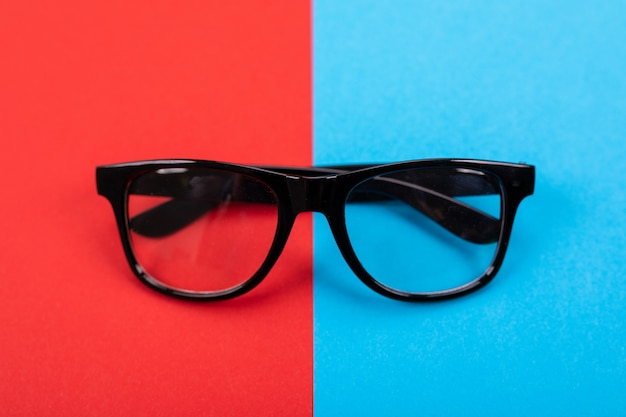 Glasses isolated on blue and red