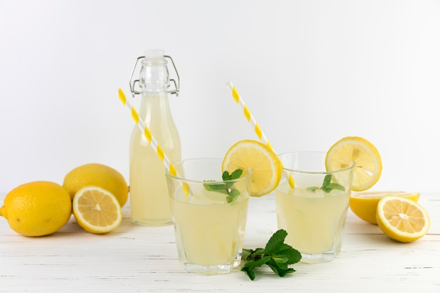 Glasses of lemonade with straws