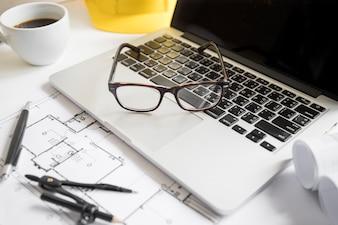 Glasses lying on laptop