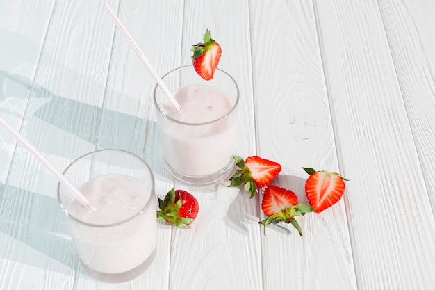 Glasses of milkshake with strawberries