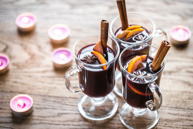 Glasses of mulled wine in candlelight