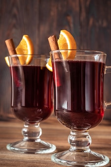 Glasses of mulled wine garnished with cinnamon and orange