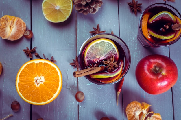 Glasses of mulled wine with oranges and apple