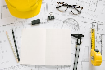 Glasses near drafting supplies and hardhat
