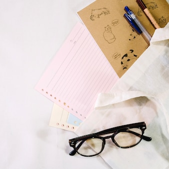 Glasses near notebook pages