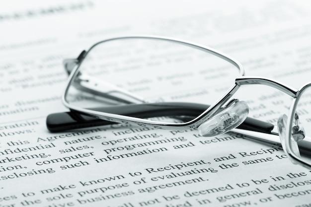 Glasses on newspaper. macro view