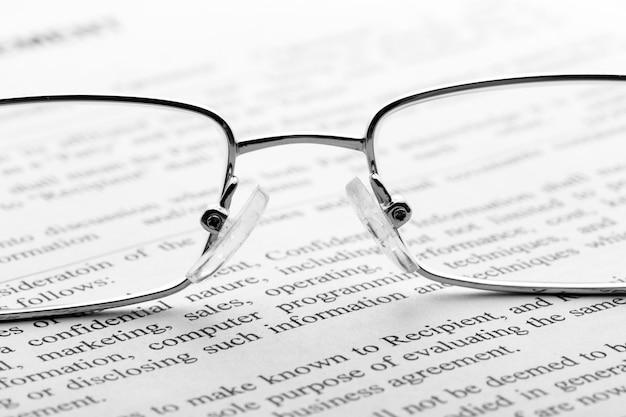 Glasses on newspaper. macro
