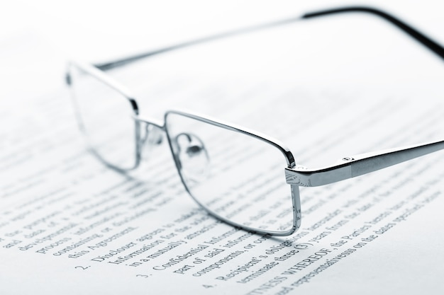 Glasses on newspaper. toned
