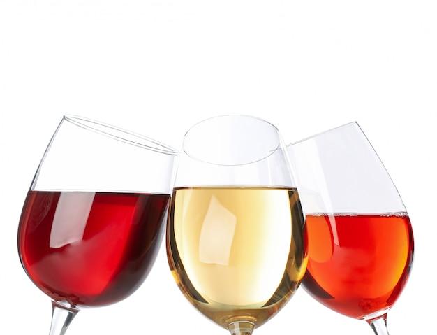 白い背景で隔離のワインのグラス Premium写真